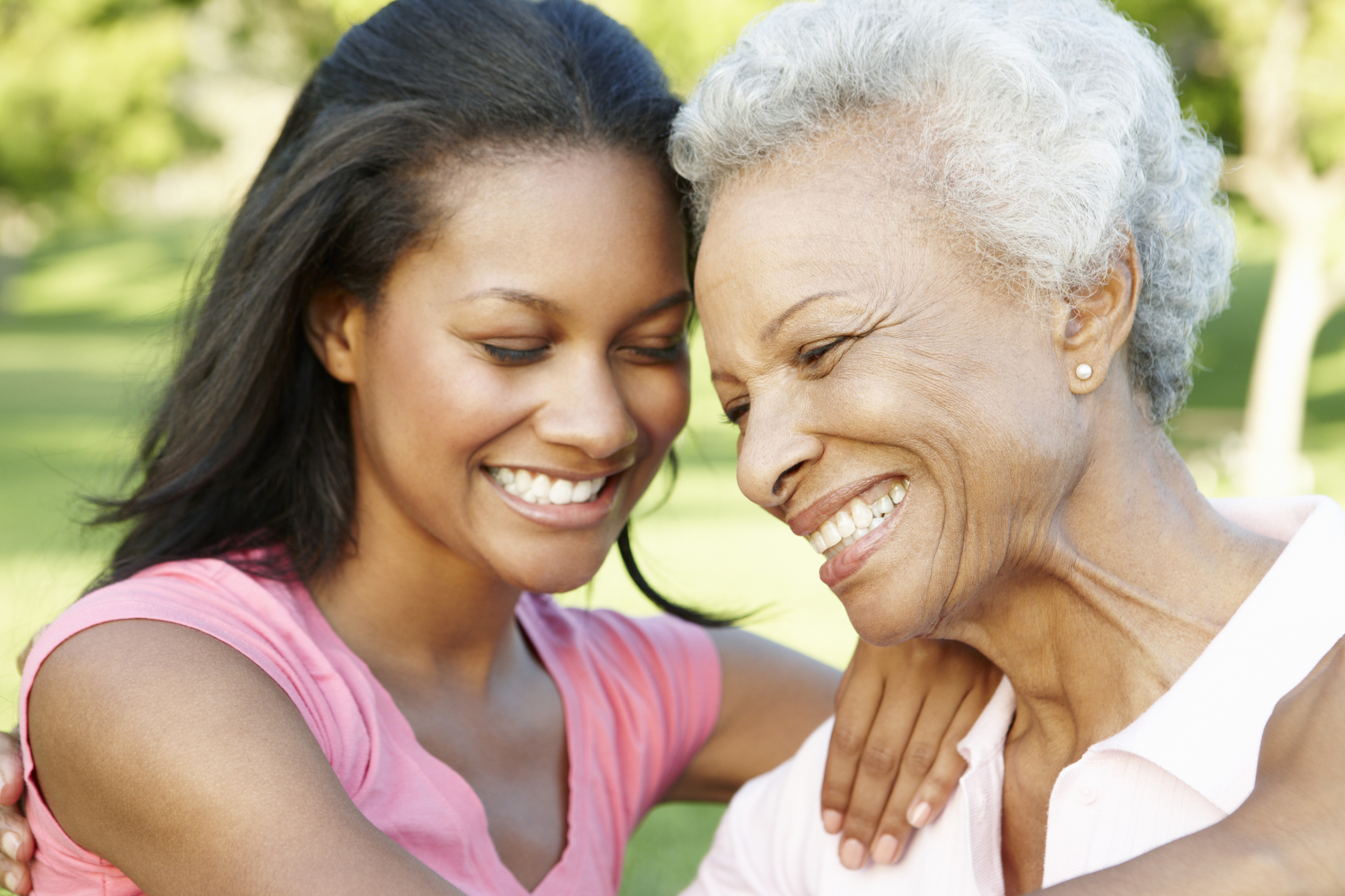 african-american-mother-and-adult-daughter-relaxing-in-park-1